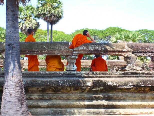Buddhist Monks on a Bridge in Cambodia