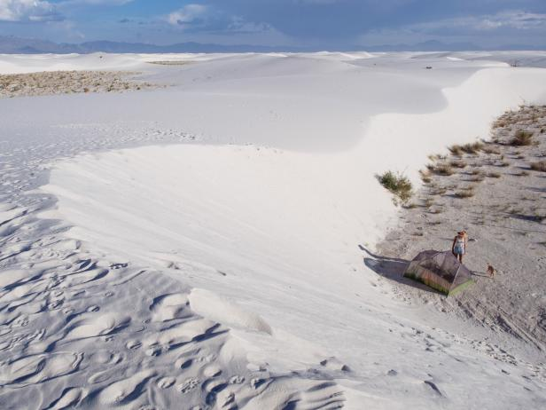 Woman and Dog Camping at White Sands, New Mexico