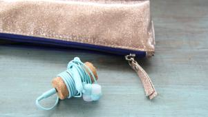 earbuds wrapped around wine cork