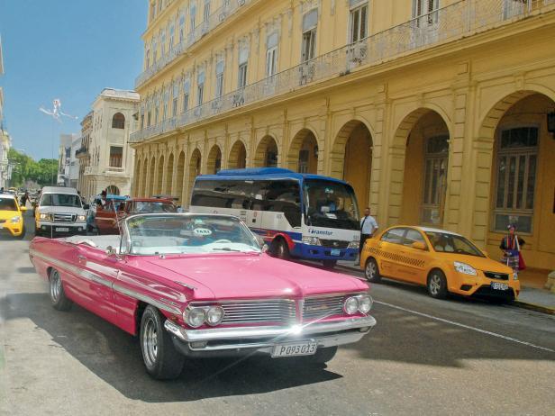A pink 1962 Pontiac convertible