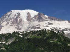 The landscape of Mt. Rainier National Park is punctuated by the enormity of the mountain itself -- a 14,000-foot-tall volcano looming over surrounding forests and meadows.
