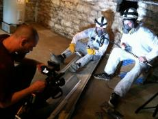 Aaron films Zak and Nick in Hazmat suits