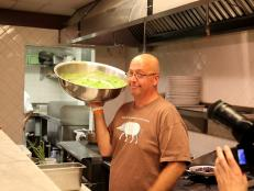 Andrew Zimmern holds pea and watercress puree