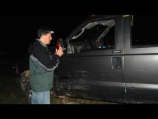 Robert E. Ziel prepares for a night investigation of momo