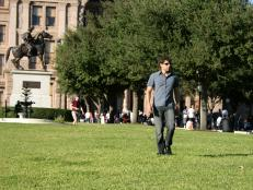 Marcus Sakey walking in front of the Texas Capitol building
