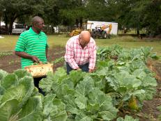 Andrew Zimmern with Melvin Green