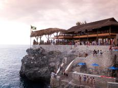 In western Jamaica, hotels and restaurants line the waterfront; fortunately building codes limit structures to the height of a palm-tree and prevent the beach from feeling overdeveloped.