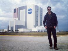 Don Wildman in front of the Kennedy Space Center
