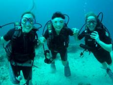 The Lost Girls SCUBA dive and climb Mount Kinabalu.