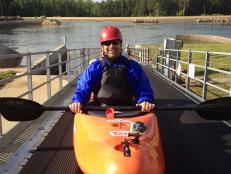 Don Wildman getting ready to kayak whitewater