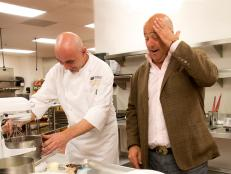 Andrew Zimmern watches a chef in Las Vegas