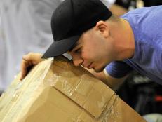 Mark Meyer peeking inside a box