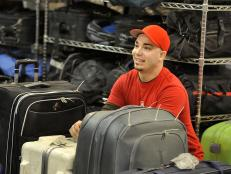Mark Meyer inspects luggage in Toronto