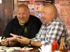 Andrew Zimmern eats oysters in Baltimore