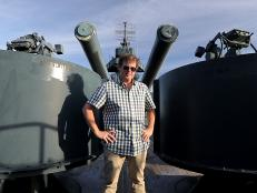 George Motz poses on the Battleship TEXAS