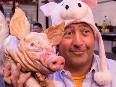 Andrew Zimmern with suckling pig