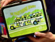 "On the Platinum Hits episode, Billy Leroy wins a bid for a vintage Partridge Family lunch box. But what's the cost? Did Billy put in the entire ""kit and caboodle"" for this win?"