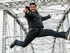 Adam Richman jumps in the air