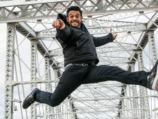 Adam Richman jumps in the air
