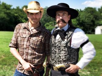 Josh Gates poses with a member of a 19th century gun club in Oklahoma