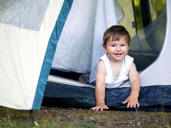 toddler in tent while camping