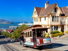 cable car, hyde street, san francisco, california, alcatraz in background, daytime