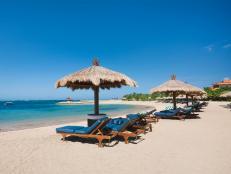 nusa beach, lounge chairs, umbrellas, bali, indonesia