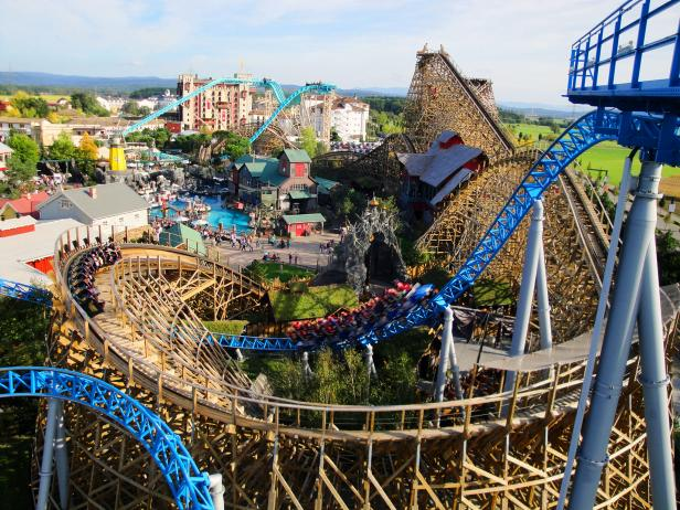 wooden roller coaster, amusement park, daytime, blue sky,