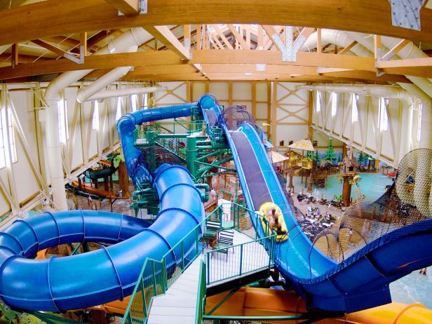 indoor water park, slides, water rides, people,