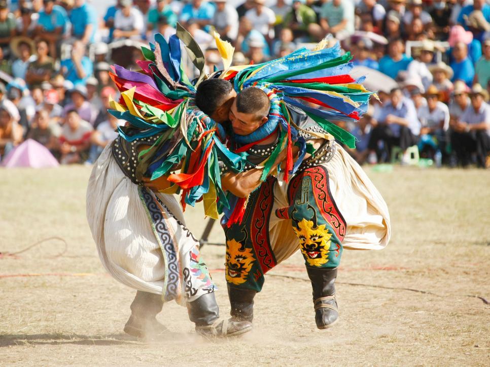 http://travel.home.sndimg.com/content/dam/images/travel/fullset/2015/06/09/summer-festivals-around-world-slideshow/naadam-festival-wrestlers-mongolia.jpg.rend.hgtvcom.966.725.suffix/1491581388333.jpeg