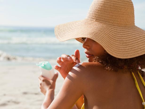 woman, applying sunscreen, beach