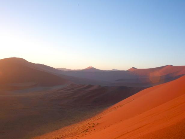 red dunes during sunrise in namibia desert in africa