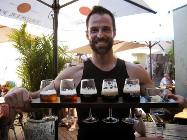 Ewan Porter Holds Beer Tray
