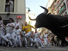 Head to Spain to run with the bulls during the San Fermin Festival.