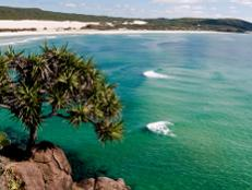 Perched on the sunny Queensland coast 161 miles northeast of Brisbane, Fraser Island is the world's largest sand island and home to one of the world's best beaches.