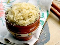 Watch Andrew Zimmern cook a traditional Munchen Sauerkraut Dinner . Then prepare the dish in your own kitchen.