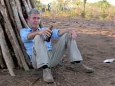 Tony Bourdain with beer in Mozambique