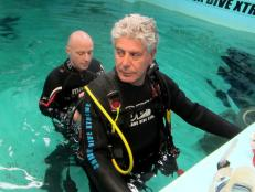 Bourdain gets ready for a shark dive