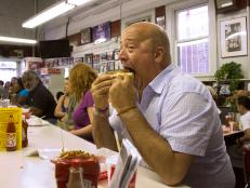 Andrew Zimmern eats a Ben's Chili Dog in Washington DC