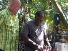 Andrew Zimmern with cooks catch of the day with Thomas Daley in St. Croix