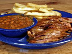 barbecue sausage, baked beans and french fries at Sonny's in Texas