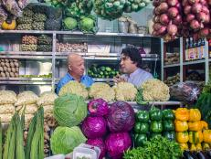 Andrew Zimmern among produce in Lima