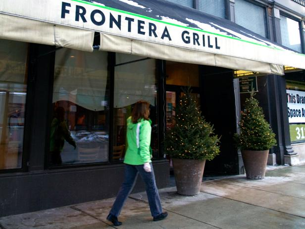 woman walking outside of the frontera grill