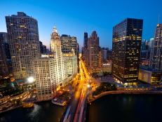 aerial view of tall buildings and busy street at dusk in chicago